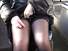 girl checks her stockings in a bus