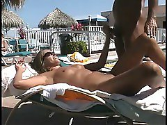 Couple sucks and fucks at the pool