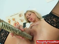 Mature does her own exam and masturbates