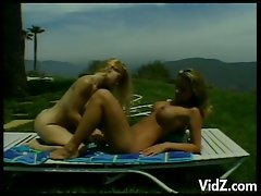 Two gorgeous yet perverted blonde babes licking cunts outdoors