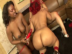 Three ebony chicks and a strap on