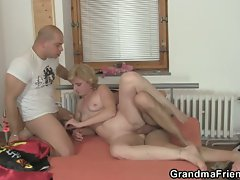Granny enjoys fucking two cocks