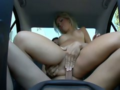 Sexy blonde bitch getting fucked in the car.
