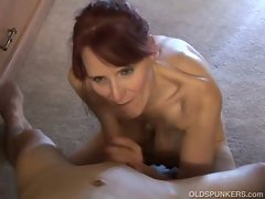 Slutty redhead granny giving head