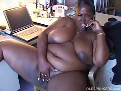 Black bbw enjoying phone sex while rubbing fat pussy