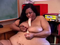 Super sized bbw uses dildo to pleasure fat pussy in classroom