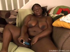 Horny black fatty masturbating with a dildo.