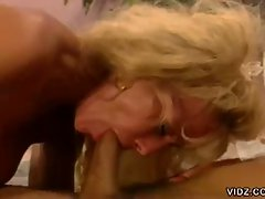 Blonde milf gives young dude a great blowjob