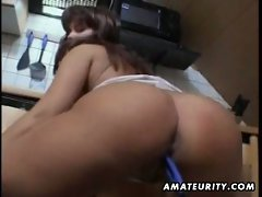 Big tits amateur plays with her pussy in the kitchen