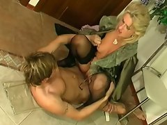 Blonde milf in stockings fucks younger guy