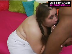 Naughty brunette bbw taking one massive black cock down throat