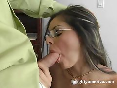 Kinky Mikayla sucks hard on a throbbing shaved cock during work at the office