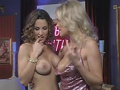Lisa Ann and her lesbian friend show how to play with their tits