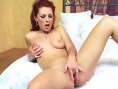 Redhead babe Alexandra Ivy plays with her nice tits and stuffs her pink pussy