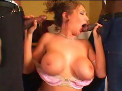 Kiki Daire gets in two black large hard dicks in her mouth alternately