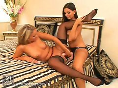 Eve Angel and Tiffany Rose are strap-on together and licking