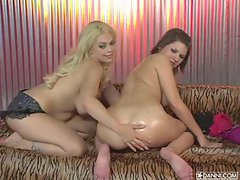 Slutty Leah Livingston and gal pal oil each other up
