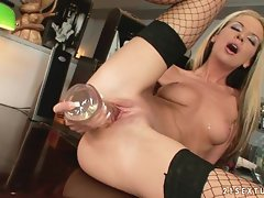 Bambi uses a glass toy to fuck her shaved pussy and cum hard