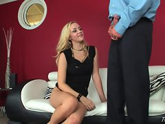 Sexy Annette Schwarz stuffs her moist mouth with a huge cock