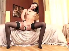 Sexy brunette Rihanna Samuel plays with her tight pussy using a huge dildo