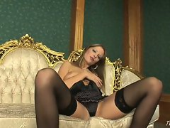 Big titted solo babe Carmen Gemini shows off her sexiest lingerie
