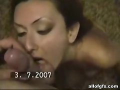Nasty brunette sucking cock in home video