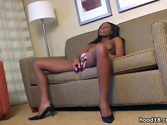 Sexy black girl pleasing herself