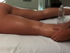 Masseur takes his job very seriously when giving a babe a massage