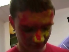 Sexy college students with their faces painted during a hazing