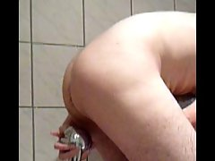 Shower head insertion enema