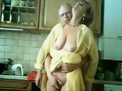 Mommy and daddy having fun in the kitchen. Stolen video
