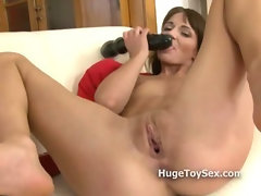 Pussy gets stretched out like crazy by a girl with a massive toy fucking herself