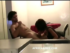Black teen enjoys european white cock in her mouth filmed in africa