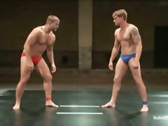 Horny men wrestling each other