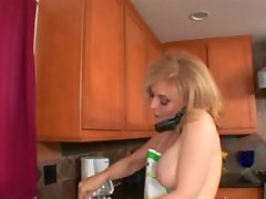 Nina Hartley is a housewife who gets a mid day black dick in her