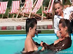 Wet lesbians touching tits in the pool