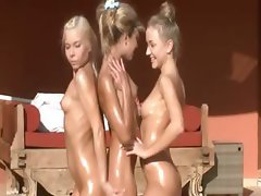 Morning exercises with three naked woman