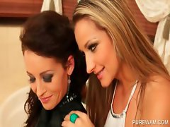 Lesbo hottie gets WAM in the bathroom