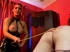 Dominatrix Annabelle gives the cane