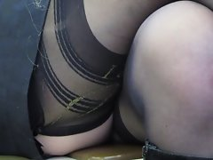 Chick check her dress and stockings in train