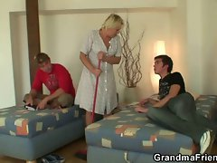 Tempting blonde granny accepts two penises