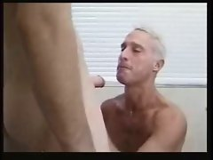 Attractive mature gay gets furious session.