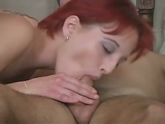 Horny redhead in a hot threesome fuck