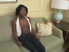 The thin ebony babe get drilled by a white dick on the coach