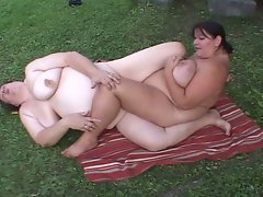 Horny fat lesbians pleasuring pussy in the beach