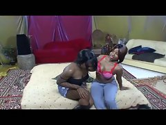 Hot lesbian ebony babes take on each other with this big dildo