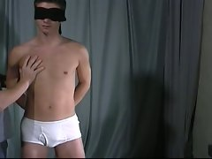 Sexy twink is blindfolded while masked man jacks him off