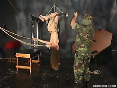 The masked man puts her in extreme bondage