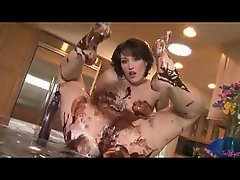 Girl having messy fun with chocolate syrup