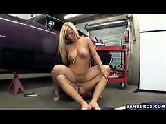Sexy older babe sitting on hard meat in a garage